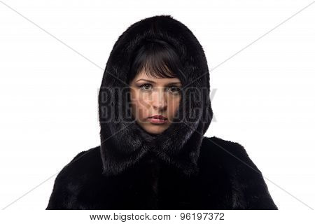 Portrait of brunette in black fur coat