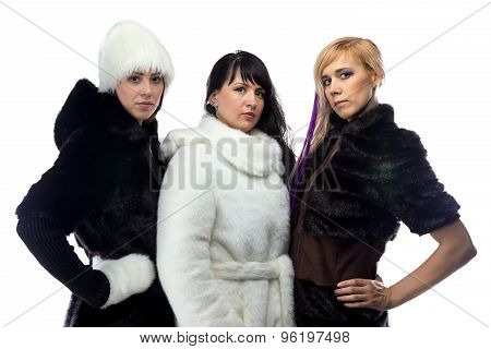 Photo of three women in fur coats