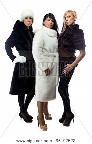 Three women in fur coats, full length
