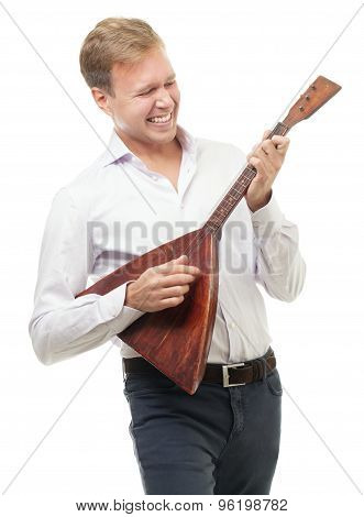 Excited young man playing balalaika, isolated on white