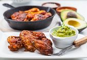 pic of chicken wings  - Grilled chicken legs and wings with guacamole - JPG
