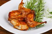 pic of quail  - Grilled quail with rosemary on the wood background - JPG