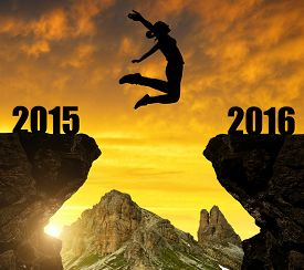 stock photo of jumping  - Girl jumps to the New Year 2016 - JPG