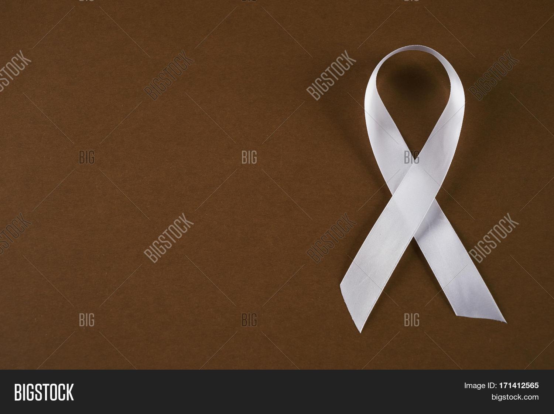 White awareness ribbon on brown image photo bigstock white awareness ribbon on brown background symbol of anti violence against women safe motherhood buycottarizona Choice Image