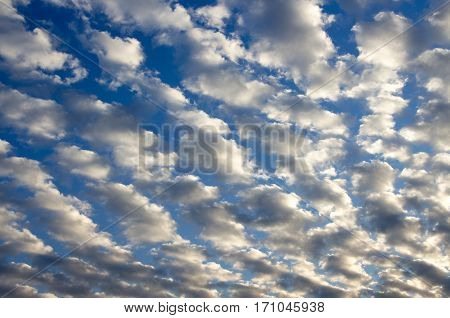 Cumulus clouds with blue sky in the background