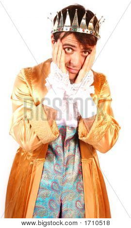 Shy Attractive Young Man Prince With Face In Hands In Shame And Fear Dressed In Golden Robes