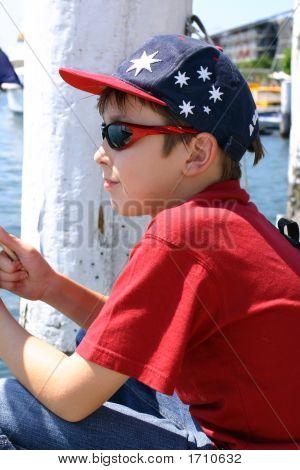 Child Sitting On Jetty Wharf