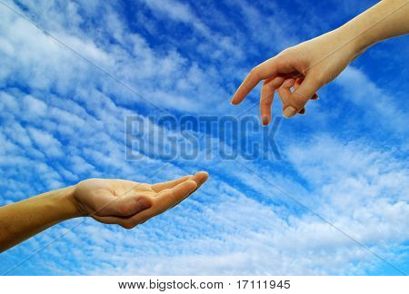 Extended hand for help on a sky background