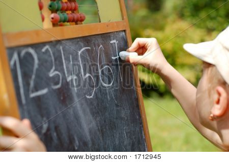Young Girl Learning Numbers