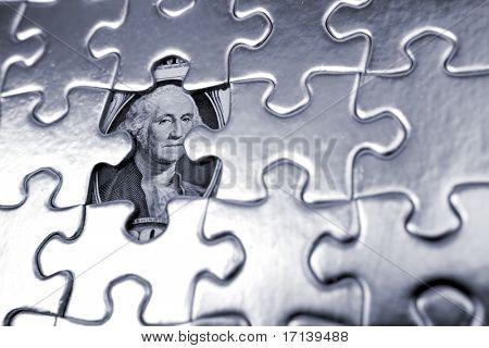 One dollar U.S. banknote behind puzzle