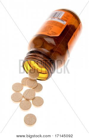 Vitamin C tablets spilling from bottle