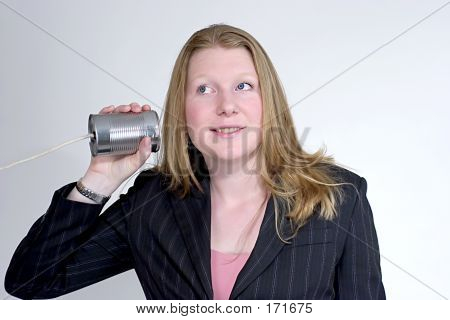 Young Woman Wearing Suit Listening To A Can Phone