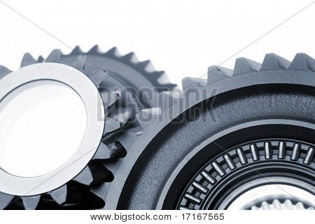 Two cogs connecting over white