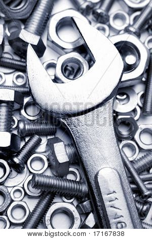 Chrome wrench on nuts and bolts