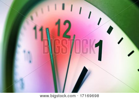 Hands of clock pointing to midday