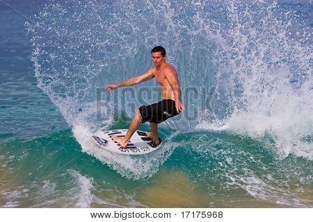 MAUI, HAWAII, May 24, 2008: Professional skimboarder Keith Fowler makes a huge spray at Makena Beach on May 24, 2008 Makena, HI.