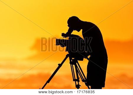 The Cameraman, Silhouette of Man with Video Camera at Sunset