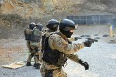 foto of gunshot  - police unit in training fire - JPG