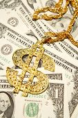 stock photo of gangster necklace  - Golden dollar - JPG