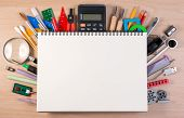 Notebook Over School Supplies Or Office Supplies On School Table. Background With School Or Office M poster
