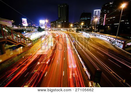 blurred bus light trails in downtown night-scape in hongkong.