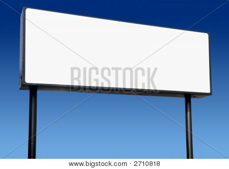 Long White Billboard And A Blue Sky.