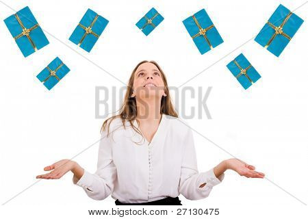 Excited beautiful woman with many gift boxes