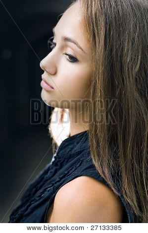 Closeup Portrait Of Gorgeous Young Brunette Girl.