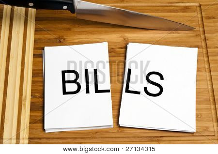 Knife cut paper with bills word