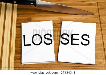 Knife cut paper with losses word