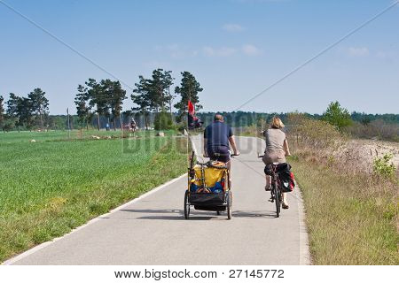family cycling around the lake