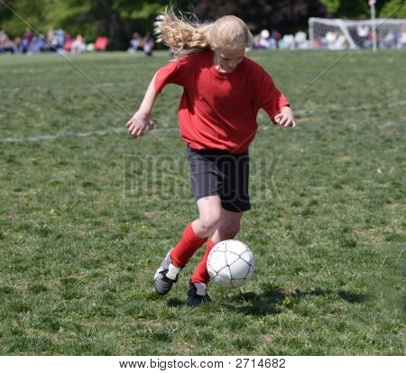 Youth Soccer Player Kicking Ball 3