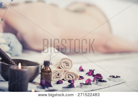poster of Beautiful Girl In Spa Salon. Adult Woman Having Hot Stone Massage In Spa Salon. Beauty Treatment Con