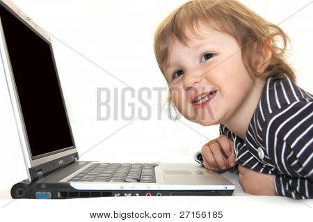 baby girl working on laptop isolated white