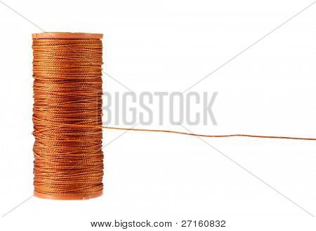 Close-up of the orange strong thread spool isolated on white