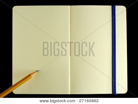 Classic opened moleskine note book with pencil isolated on black background