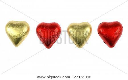 Four chocolate hearts isolated on white (for the St.Valentine's Day)