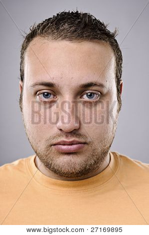 Intense portrait of overweight man, high detail