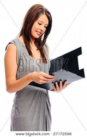 Attractive businesswoman looking at a file containing important documents
