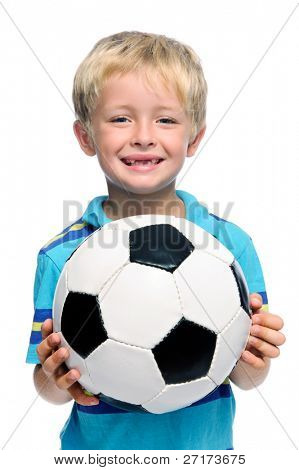 Happy boy stands with a football, aspiring to be a professional soccer player