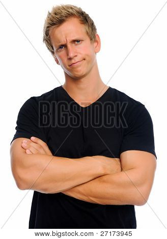 Annoyed male crosses his arms in disappointment; isolated on white