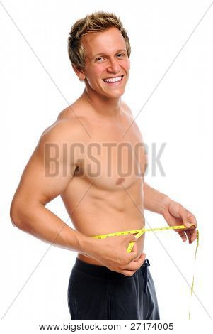 Attractive caucasian man is happy with his new waist measurement