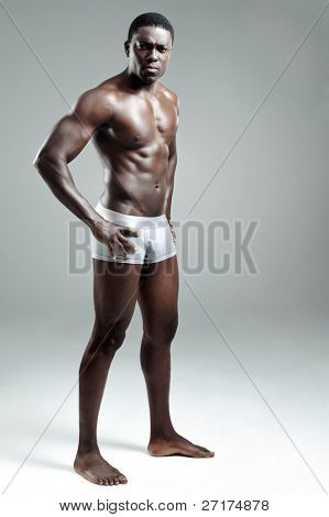 Sexy black model striking a pose in the studio