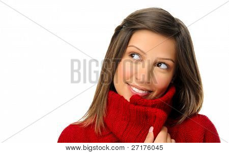 carefree girl looks away thinking with red knitted coat