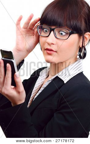 shocked businesswoman holding mobile phone isolated on white