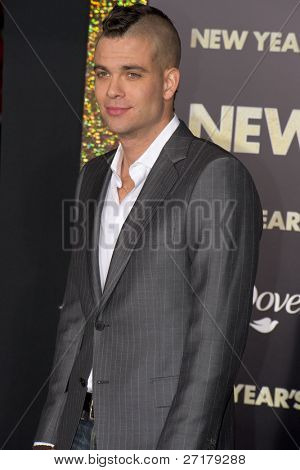 HOLLYWOOD, CA - DECEMBER 5: Actor Mark Salling arrives at the premiere of