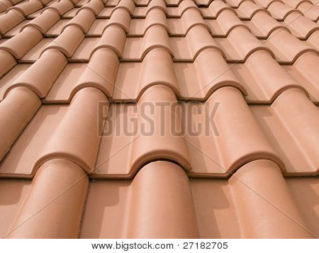 New orange roof tiles close up detail