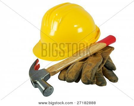 Yellow hardhat, old leather gloves and hammer isolated on white background