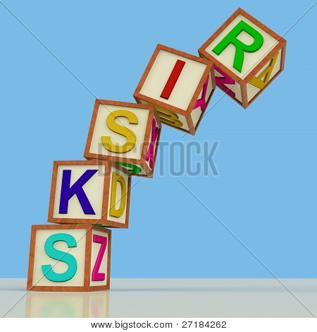 Blocks Spelling Risks Falling Over As Symbol for Danger Or Chanc