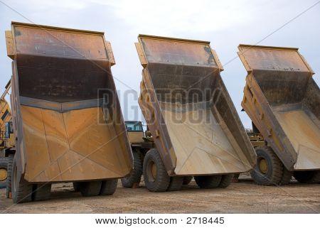 Three Dump Trucks